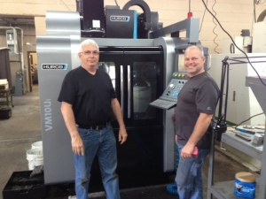 Steve Flood and Steve Flood, Jr. stand in front of Truex's new Hurco VM10Ui 5-axis Machining Center.